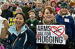 "Karyn Kuan (left) and Shannon Parks-Beck, with other members of First United Methodist Church of Seattle, participate in a January 13, 2013, demonstration in downtown Seattle calling for stricter regulations of firearms. Sponsored by a network of churches and other groups called ""Stand-up Washington,"" the demonstrators called for a state ban on semi-automatic weapons as well as stricter gun laws."
