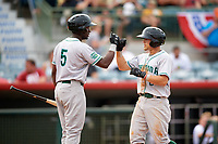 Daytona Tortugas TJ Friedl (6) fist bumps Taylor Trammell (5) after hitting a home run in the top of the fifth inning during a game against the Florida Fire Frogs on April 7, 2018 at Osceola County Stadium in Kissimmee, Florida.  Daytona defeated Florida 4-3 in a six inning rain shortened game.  (Mike Janes/Four Seam Images)