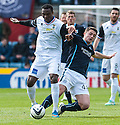 Caley's Edward Ofere is challenged by Dundee's Stephen McGinn.