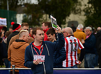 A program seller selling copies of Lincoln City's match day program, The Imp, outside the ground<br /> <br /> Photographer Chris Vaughan/CameraSport<br /> <br /> The EFL Sky Bet League Two - Lincoln City v Chesterfield - Saturday 7th October 2017 - Sincil Bank - Lincoln<br /> <br /> World Copyright &copy; 2017 CameraSport. All rights reserved. 43 Linden Ave. Countesthorpe. Leicester. England. LE8 5PG - Tel: +44 (0) 116 277 4147 - admin@camerasport.com - www.camerasport.com