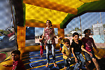 Palestinian children play at an amusement park on the third day of Eid al-Fitr holiday which marks the end of the Muslim holy month of Ramadan, in Gaza City on June 27, 2017. Photo by Ashraf Amra