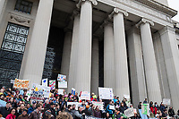 People gather outside of MIT's Building 7, the traditional entrance to the institution, as they take part in the March for Science demonstration in Cambridge, Mass., on Sat., April 22, 2017. After a rally at MIT that included a group that had marched from Harvard University, the combined groups then marched to Boston Common to join the large rally there.