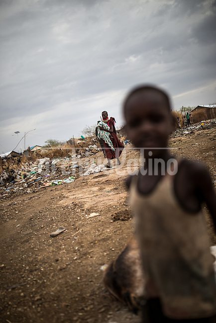 A woman with her baby iin Kakuma refugee camp in Kenya.Kakuma refugee camp in North of Kenya. Kakuma is the site of a UNHCR refugee camp, established in 1991. The population of Kakuma town was 60,000 in 2014, having grown from around 8,000 in 1990. In 1991, the camp was established to host the 12,000 unaccompanied minors who had fled the war in Sudan and came walking from camps in Ethiopia.
