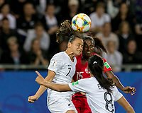GRENOBLE, FRANCE - JUNE 15: Ali Riley #7 of the New Zealand National Team, Nichelle Prince #15 of the Canadian National Team battle for head ball during a game between New Zealand and Canada at Stade des Alpes on June 15, 2019 in Grenoble, France.