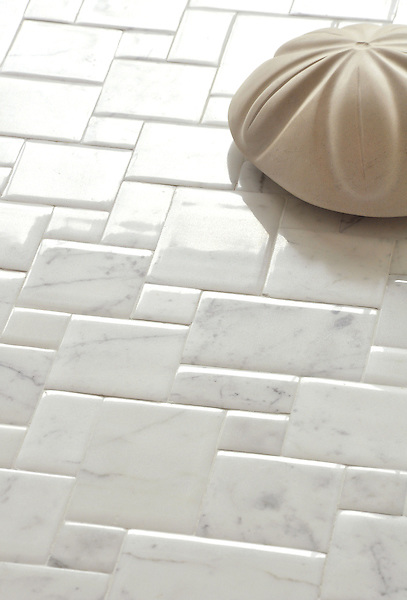 Versailles, a handmade tile shown in Calacatta with a Lucido finish, was designed by Giovanni Barbieri for New Ravenna. <br />