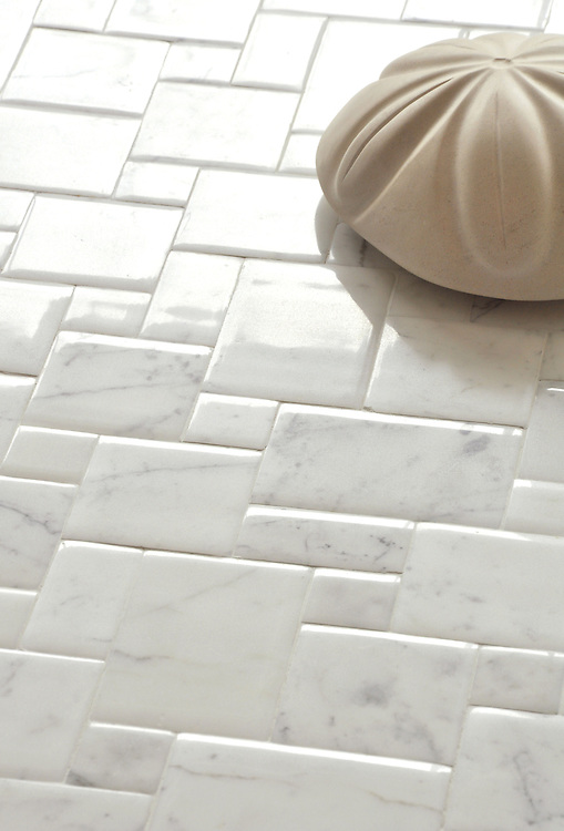 Versailles, a handmade tile shown in Calacatta with a Lucido finish, was designed by Giovanni Barbieri for New Ravenna. <br /> <br /> For pricing samples and design help, click here: http://www.newravenna.com/showrooms/