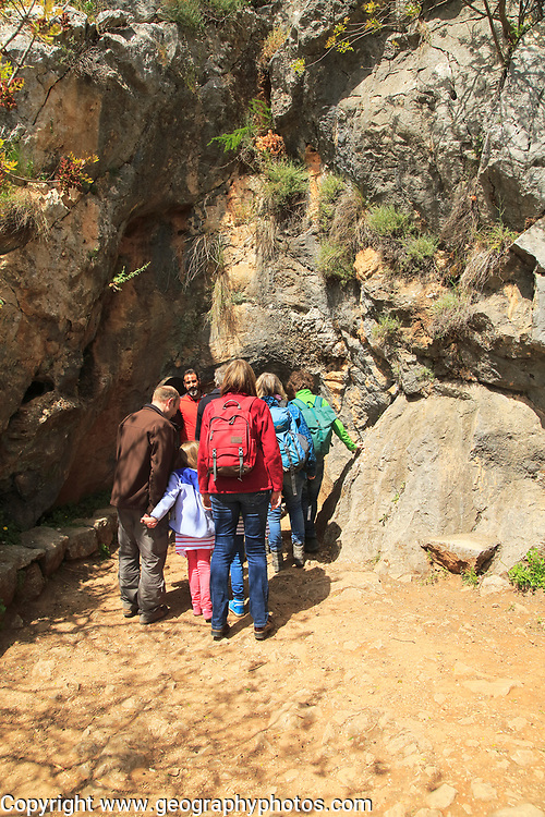 People entering the cave entrance, Cueva de la Pileta, near Ronda, Malaga province, southern Spain