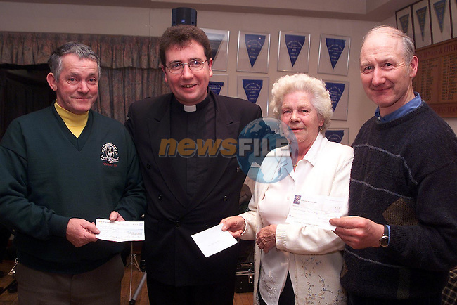 Larry Clarke, Navan Road Club, Delia Reilly, Slane ICA and Michael Flood, Stackallen Lawn Tennis Pitch and Putt Club presenting cheques to Fr. Martin Carley, chairman Cairde...Camera:   DCS620C.Serial #: K620C-01943.Width:    1728.Height:   1152.Date:  5/12/99.Time:   17:33:03.DCS6XX Image.FW Ver:   1.9.6.TIFF Image.Look:   Product.Counter:    [1437].Shutter:  1/50.Aperture:  f5.6.ISO Speed:  400.Max Aperture:  f3.5.Min Aperture:  f22.Focal Length:  24.Exposure Mode:  Manual (M).Meter Mode:  Color Matrix.Drive Mode:  Continuous High (CH).Focus Mode:  Single (AF-S).Focus Point:  Center.Flash Mode:  Normal Sync.Compensation:  +0.0.Flash Compensation:  +0.0.Self Timer Time:  10s.White balance: Auto (Flash).Time: 17:33:03.104.