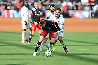 WASHINGTON, DC - FEBRUARY 29: Washington, D.C. - February 29, 2020: Russell Canouse #4 of D.C. United battles the ball with Andre Shinyashiki #99 of the Colorado Rapids. The Colorado Rapids defeated D.C. Untied 2-1 during their Major League Soccer (MLS)  match at Audi Field during a game between Colorado Rapids and D.C. United at Audi Field on February 29, 2020 in Washington, DC.