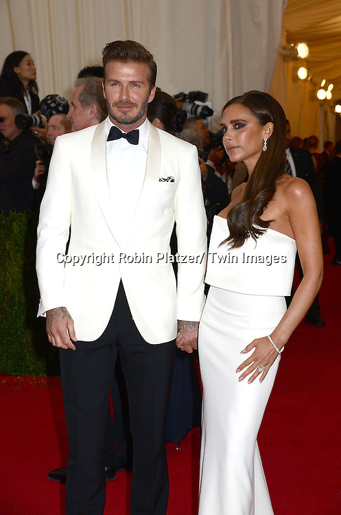 David Beckham and Victoria Beckham attend the Costume Institute Benefit on May 5, 2014 at the Metropolitan Museum of Art in New York City, NY, USA. The gala celebrated the opening of Charles James: Beyond Fashion and the new Anna Wintour Costume Center.