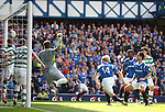 The header from Nikica Jelavic bounces down then back up into the net og Celtic keeper Fraser Forster for Rangers' second goal