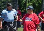 WATERBURY,  CT-071918JS03--Wolcott coach Dave Pelletier, right, chats with the home plate umpire between innings of their during their Roberto Clemente tournament game with Diamond Elite of Cincinnati (OH) Thursday at Municipal Stadium in Waterbury. <br /> Jim Shannon Republican American