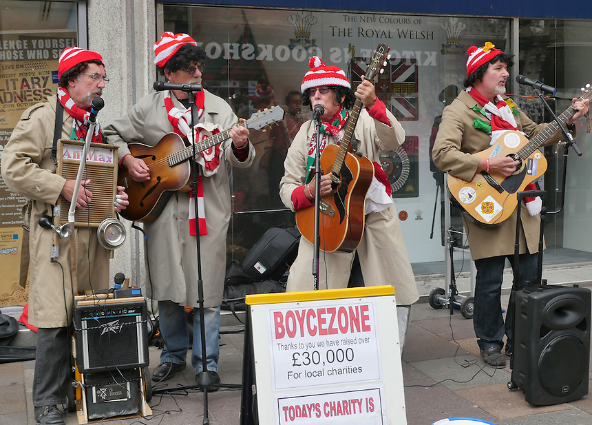 Welsh fans dressed as Max Boyce entertain the crowds on the streets of Cardiff <br /> <br /> Photographer Ian Cook/CameraSport<br /> <br /> Rugby Union - 2015 Rugby World Cup - Wales v Uruguay - Sunday 20th September 2015 - Millennium Stadium - Cardiff<br /> <br /> &copy; CameraSport - 43 Linden Ave. Countesthorpe. Leicester. England. LE8 5PG - Tel: +44 (0) 116 277 4147 - admin@camerasport.com - www.camerasport.com