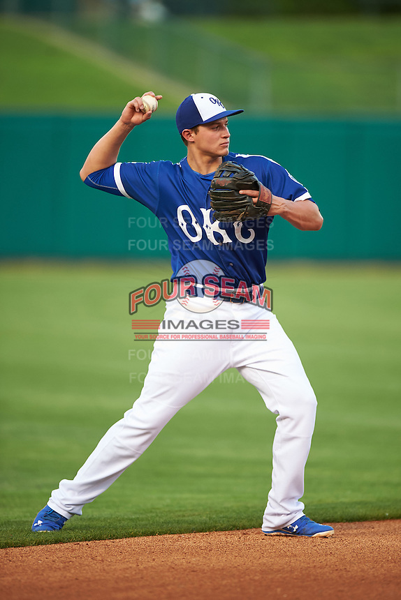 Oklahoma City Dodgers shortstop Corey Seager (18) warmup throw to first during a game against the Fresno Grizzles on June 1, 2015 at Chickasaw Bricktown Ballpark in Oklahoma City, Oklahoma.  Fresno defeated Oklahoma City 14-1.  (Mike Janes/Four Seam Images)