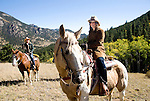 Young woman, teenager outdoors horseback riding on a crisp and cool fall morning amid aspen groves high in the Rocky Mountains, near Estes Park, Colorado, USA (MR #88)