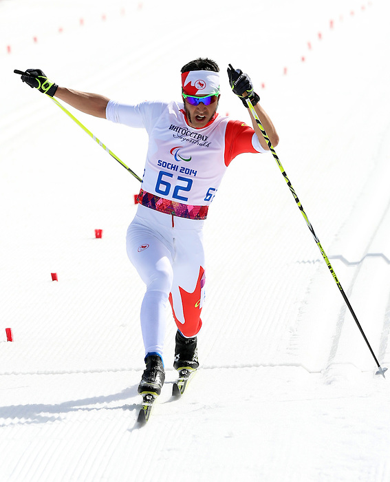 10/03/2014. Canadian Brian Mckeever and guide Erik Carleton compete in the cross country mens 20km  Visually impaired event at the Sochi 2014 Paralympic Winter Games in Sochi Russia. Mckeever went on to win gold. (Photo Scott Grant/Canadian Paralympic Committee)