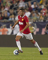 Manchester United FC forward Federico Macheda (27) dribbles. In a Herbalife World Football Challenge 2011 friendly match, Manchester United FC defeated the New England Revolution, 4-1, at Gillette Stadium on July 13, 2011.