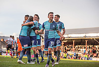 Matt Bloomfield of Wycombe Wanderers & the team celebrate there win at full time during the Sky Bet League 2 match between Grimsby Town and Wycombe Wanderers at Blundell Park, Cleethorpes, England on 4 March 2017. Photo by Andy Rowland / PRiME Media Images.