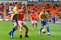 Blackpool's Brad Potts under pressure from Accrington Stanley's Harvey Rodgers<br /> <br /> Photographer Terry Donnelly/CameraSport<br /> <br /> The EFL Sky Bet League Two - Blackpool v Accrington Stanley - Friday 14th April 2017 - Bloomfield Road - Blackpool<br /> <br /> World Copyright &copy; 2017 CameraSport. All rights reserved. 43 Linden Ave. Countesthorpe. Leicester. England. LE8 5PG - Tel: +44 (0) 116 277 4147 - admin@camerasport.com - www.camerasport.com