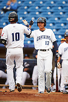 Lake County Captains Claudio Bautista (10) is greeted by Yu-Cheng Chang (13) after hitting a home run during a game against the Fort Wayne TinCaps on May 20, 2015 at Classic Park in Eastlake, Ohio.  Lake County defeated Fort Wayne 4-3.  (Mike Janes/Four Seam Images)