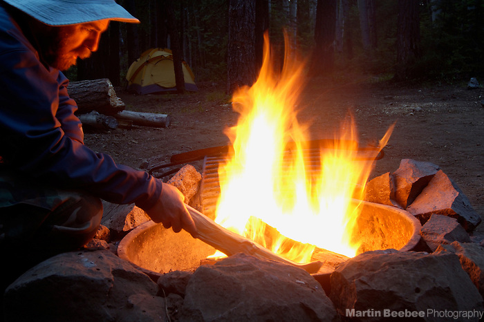 Man stoking campfire, Apache-Sitgreaves National Forest, Arizona