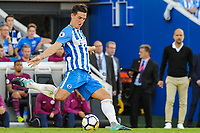 Lewis Dunk of Brighton & Hove Albion (5)   during the EPL - Premier League match between Brighton and Hove Albion and Manchester City at the American Express Community Stadium, Brighton and Hove, England on 12 August 2017. Photo by Edward Thomas / PRiME Media Images.