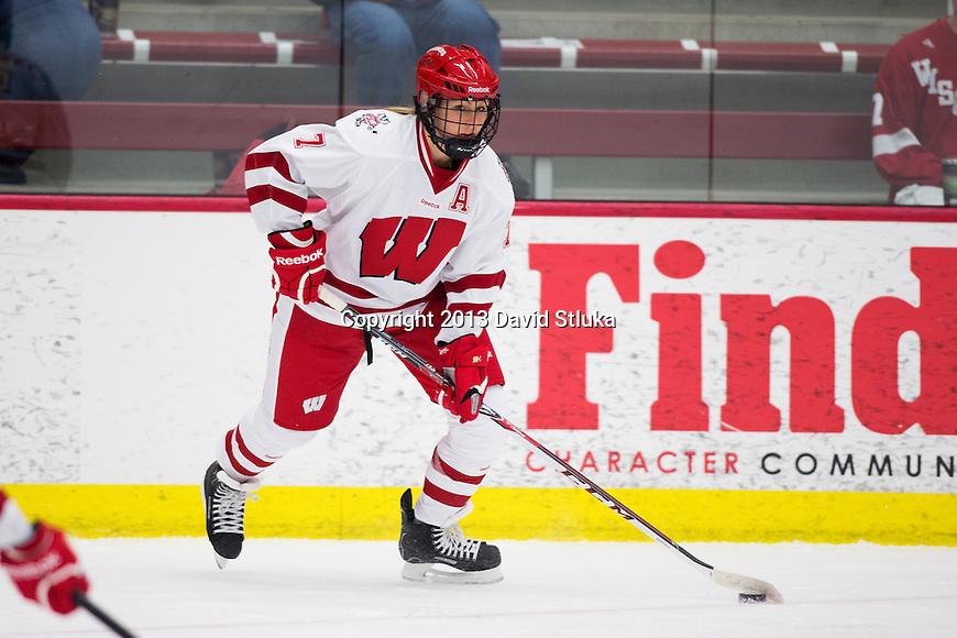 Wisconsin Badgers Kelly Jaminski (7) handles the puck against Team Japan during a women's hockey exhibition in Madison, Wisconsin, on September 23, 2013. The Badgers won 3-0. (Photo by David Stluka)