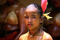 a trditional palauan girl during a festival in Palau, note the oil over their body