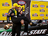 Feb 28, 2016; Chandler, AZ, USA; NHRA top fuel driver Leah Pritchett kisses husband Gary Pritchett as they celebrate after winning the Carquest Nationals at Wild Horse Pass Motorsports Park. Mandatory Credit: Mark J. Rebilas-USA TODAY Sports