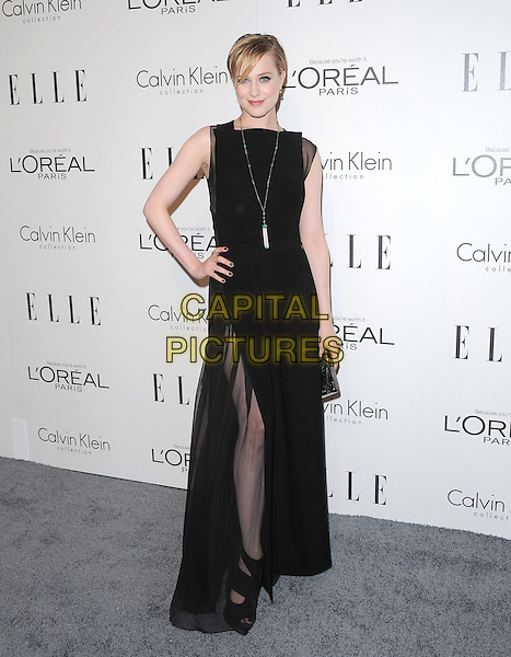 Evan Rachel Wood.18th Annual ELLE Women in Hollywood celebration held at The Four Seasons in Beverly Hills, California, USA..October 17th, 2011.full length black sleeveless necklace sheer dress hand on hip clutch bag slit split thigh leg.CAP/RKE/DVS.©DVS/RockinExposures/Capital Pictures.