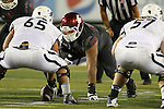 Kalafitoni Pole prepares to clog up the middle of the line during the Washington State Cougars non-conference road opener against the Nevada Wolfpack at Mackay Stadium in Reno, Nevada, on September 5, 2014.