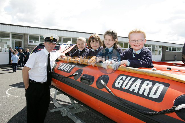 Irish Coast Guard Member   with Students   from School..Photo: Newsfile/Fran Caffrey..The summer is here and the Drogheda Coast Guard Unit are back visiting the local Primary Schools for their Annual Water Safety Talk..This has been a very successful campaign over the last four years; we have educated thousands of children in all aspects of Water Safety form the Louth and Meath Areas..We introduce the children to the basic dangers that they are likely to encounter when visiting the seaside, lakes and rivers. We also teach them the Safe Swimming Guide..We demonstrate the wearing of Lifejackets and Buoyancy Aids, how to get help if the find someone in trouble in the water, at the seaside or near cliffs..We also demonstrate the equipment that the Coast Guard wear and use in different areas of operations..The children are then brought into the schoolyard where we show them one of our Coast Guard Boats and all Life Saving Equipment on board..Last year we visited thirty schools reaching approx. three thousand children..We wish everyone a warm and happy summer..Enjoy our local waterways and coast, always read signs, stay alert and beware of any dangers..If you see any one in difficulty in our local Rivers, Lakes or along our Coast, Call 112 or 999 and ask for the Coast Guard...Dermot Mc Connoran .Area Officer .Drogheda Coast Guard...