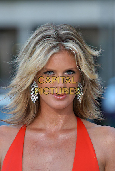 RACHEL HUNTER.Laureus World Sports Awards, Monte Carlo.www.capitalpictures.com.sales@capitalpictures.com.©Capital Pictures.flicked hair, middle parting, diamond earrings