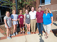 MVNU2MSU 2016. President Mark E. Keenum and children pose with the Wilson family outside Moseley Hall.<br />