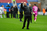 Steve Cooper Head Coach of Swansea City applauds the fans at the final whistle during the Sky Bet Championship match between Wigan Athletic and Swansea City at The DW Stadium in Wigan, England, UK. Saturday 2 November 2019