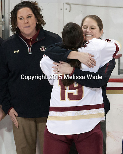Courtney Kennedy (BC - Associate Head Coach), Danielle Doherty (BC - 19), Katie King Crowley (BC - Head Coach) -  The Boston College Eagles defeated the visiting Boston University Terriers 5-0 on BC's senior night on Thursday, February 19, 2015, at Kelley Rink in Conte Forum in Chestnut Hill, Massachusetts.