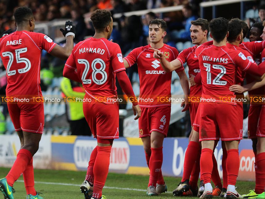 MK Dons players celebrate their second goal during Peterborough United vs MK Dons, Sky Bet EFL League 1 Football at London Road on 28th January 2017