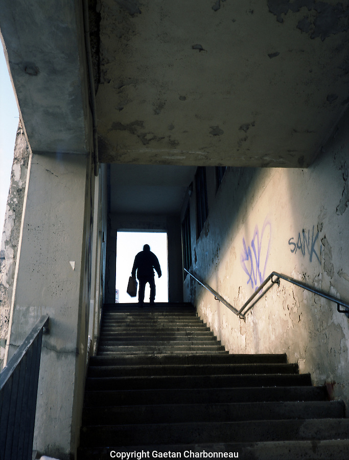 A man running up the stairs of a viaduct