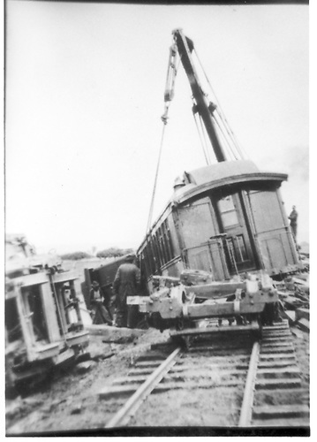 A derailment of the southbound Chili Line train has occurred at Espanola.  Derrick OP is hoisting the coach back to the rails and the RPO is on its side to the left.<br /> D&amp;RG  Espanola, NM  1921