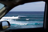 Winter swells at Ho'okipa, Maui, framed by a car window.