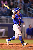 Midland RockHounds catcher Beau Taylor (24) hits a home run during a game against the Tulsa Drillers on May 30, 2014 at ONEOK Field in Tulsa, Oklahoma.  Tulsa defeated Midland 7-1.  (Mike Janes/Four Seam Images)