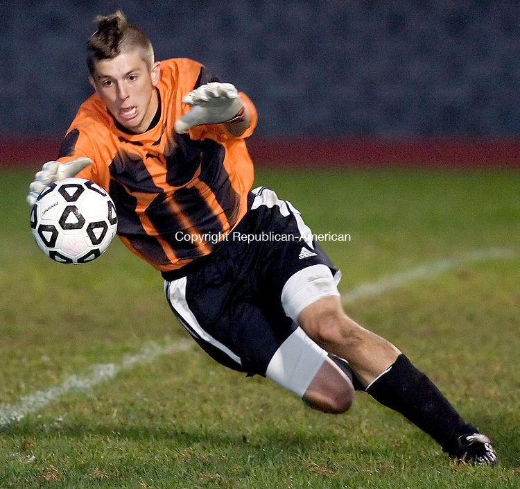 NAUGATUCK, CT- 03 OCT 2007- 100307JT01- <br /> FOR ACTION MAN:<br /> Torrington goalie Justin Duksis lunges to block a shot during Wednesday's game against Naugatuck at Naugatuck, which ended 1-1 after overtime.<br /> Josalee Thrift / Republican-American