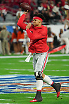 Ohio State Buckeyes quarterback Justin fields (1) warms up before the Fiesta Bowl game against the Clemson Tigers on Saturday, Dec 28, 2019 in Glendale, Ariz.  (Gene Lower via AP)