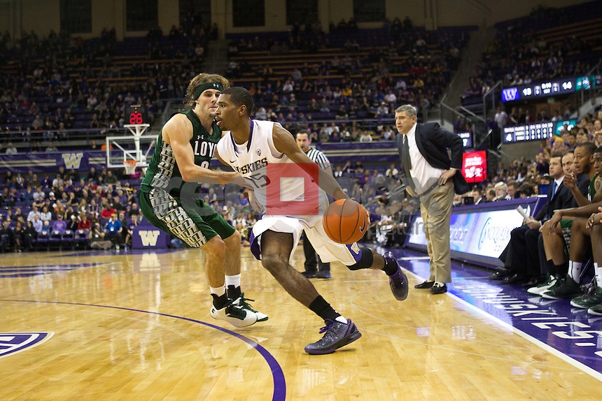 The University of Washington men's basketball team defeats Loyola-Maryland 85-63 at Alaska Airlines Arena on the UW campus on Sunday November 11, 2012. (Photography By Red Box Pictures/Max Waugh)