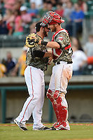 Arkansas Travelers pitcher Cam Bedrosian (37) and catcher Jett Bandy (27) after closing out the game against the San Antonio Missions on May 25, 2014 at Dickey-Stephens Park in Little Rock, Arkansas.  Arkansas defeated San Antonio 3-1.  (Mike Janes/Four Seam Images)