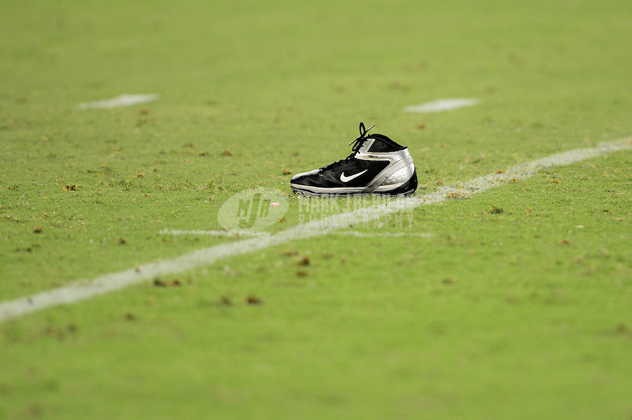 Aug. 17, 2012; Glendale, AZ, USA; The nike shoe belonging to Oakland Raiders running back Lonyae Miller sits on the field after falling off against the Arizona Cardinals during a preseason game at University of Phoenix Stadium. The Cardinals defeated the Raiders 31-27. Mandatory Credit: Mark J. Rebilas-