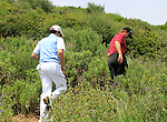Rory McIlroy (N.IRL) gives Retief Goosen (RSA) a hand to look for his ball after a wayward drive on the 14th hole during Day 1 of the Volvo World Match Play Championship in Finca Cortesin, Casares, Spain, 19th May 2011. (Photo Eoin Clarke/Golffile 2011)
