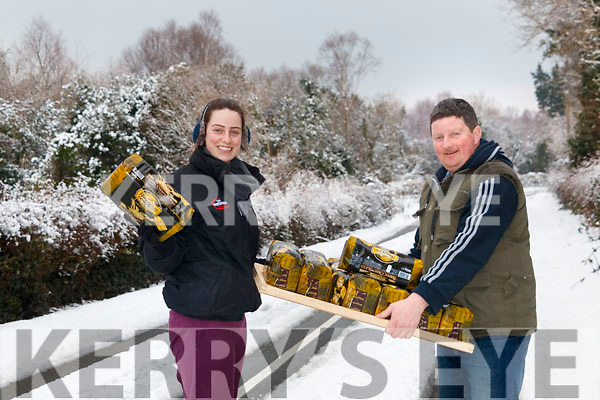 The &quot;Beast from the East&quot; is no match for Harrington Bakery in Kenmare. <br /> Pictured: Carmel O'Leary receiving a loaf of Harrington's bread from Jerry Harrington in Tuosist as he was delivering bread.