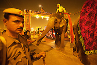 India. Uttar Pradesh state. Allahabad. Maha Kumbh Mela. A night procession under the police's supervision. The elephant is decorated with the symbols of Ganesh. The Kumbh Mela, believed to be the largest religious gathering is held every 12 years on the banks of the 'Sangam'- the confluence of the holy rivers Ganga, Yamuna and the mythical Saraswati. Ganesha, also spelled Ganesa and Ganesh, also known as Ganapati is one of the best-known and most widely worshipped deities in the Hindu pantheon. The Maha (great) Kumbh Mela, which comes after 12 Purna Kumbh Mela, or 144 years, is always held at Allahabad. Uttar Pradesh (abbreviated U.P.) is a state located in northern India. 6.02.13 © 2013 Didier Ruef
