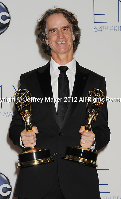 LOS ANGELES, CA - SEPTEMBER 23: Jay Roach poses in the press room at the 64th Primetime Emmy Awards held at Nokia Theatre L.A. Live on September 23, 2012 in Los Angeles, California.